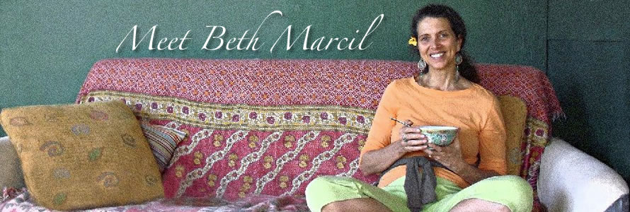 photo of beth marcil sipping tea and sitting on a sofa